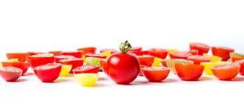 Tomates de cereza rojos y amarillos aislados Imagen de archivo libre de regalías
