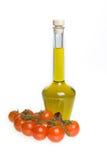 Tomates de cereza y aceite de oliva Imagen de archivo