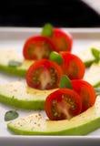 Tomates de cereza y aguacate Foto de archivo