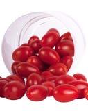 Tomates de ciruelo en vidrio fotos de archivo libres de regalías
