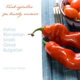 Tomates de la pimienta y de cereza de Ramiro en azul Fotos de archivo