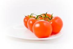 tomates de plaque de point de vue Photo libre de droits