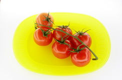 Tomates de plaque jaune Images stock