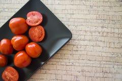Tomates de plaque noire Image stock