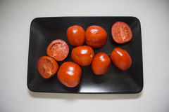 Tomates de plaque noire Photographie stock libre de droits