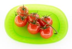 Tomates de plaque verte Photo stock
