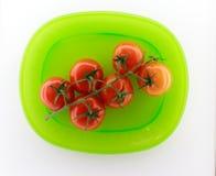 Tomates de plaque verte Image stock