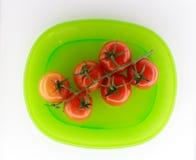 Tomates de plaque verte Photos libres de droits