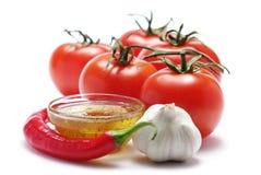 tomates de poivre de pétrole chaud d'ail Photographie stock