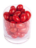 Tomates de prune en verre Photo stock