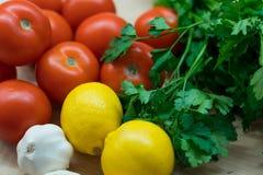 Tomates del ajo del limón del perejil Foto de archivo libre de regalías
