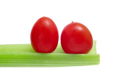 Tomates e aipo de cereja Imagem de Stock