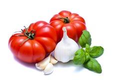 Tomates e alho Fotos de Stock
