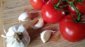 Tomates e alho Fotos de Stock Royalty Free