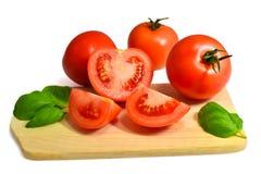 Tomates e manjericão Fotos de Stock