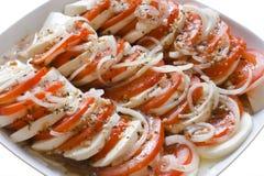 Tomates e salada do mozarella Imagens de Stock