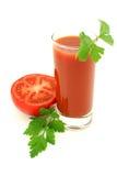 Tomates e suco. Foto de Stock