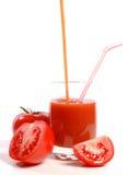 Tomates e suco de tomate Fotografia de Stock Royalty Free