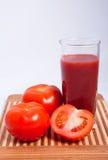 Tomates e suco de tomate Foto de Stock