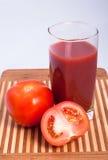 Tomates e suco de tomate Imagem de Stock Royalty Free