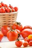 Tomates e tomates de cereja Imagens de Stock