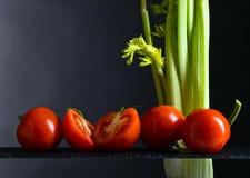 Tomates e varas de aipo Imagem de Stock