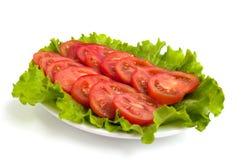 Tomates em uma bacia Imagens de Stock