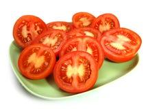 Tomates en la placa Imagen de archivo
