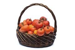 Tomates en una cesta Foto de archivo libre de regalías