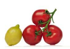 Tomates et citron rouges Photos libres de droits
