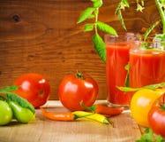 Tomates et jus Image libre de droits