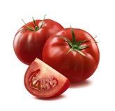 2 tomates et morceau quart sur le fond blanc Photographie stock libre de droits