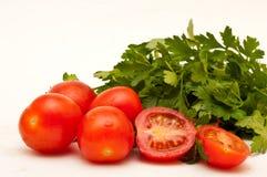 Tomates et persil Photos stock