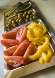 Tomates et plaque d'olives Photographie stock libre de droits