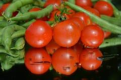 Tomates et pois frais Images libres de droits