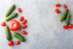 Tomates fraîches, concombres et oignons verts Images libres de droits