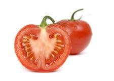 Tomates frescos en un fondo blanco Fotografía de archivo