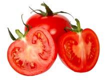 Tomates isolados em um fundo branco. Imagens de Stock