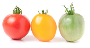 Tomates jaunes et vertes rouges d'isolement sur le fond blanc Photo stock