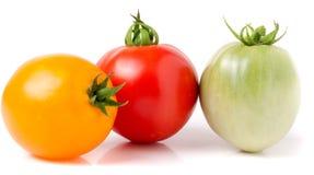 Tomates jaunes et vertes rouges d'isolement sur le fond blanc Images libres de droits