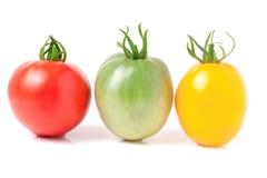 Tomates jaunes et vertes rouges d'isolement sur le fond blanc Images stock