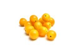 Tomates jaunes sur le blanc Photographie stock libre de droits