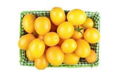 Tomates jaunes sur un fond blanc Photos libres de droits