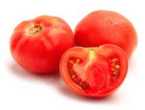 Tomates mûres fraîches sur le fond blanc Image stock