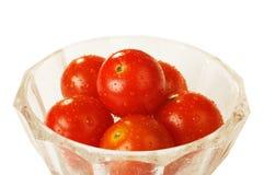 Tomates na bacia de vidro Imagem de Stock