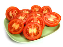 Tomates na placa Imagem de Stock