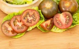 tomates negros Fotos de archivo