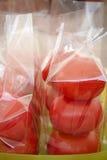 Tomates no saco de plástico Fotografia de Stock