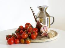 Tomates, oli et ail Photographie stock libre de droits