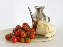 Tomates, oli et parmesan Photographie stock libre de droits
